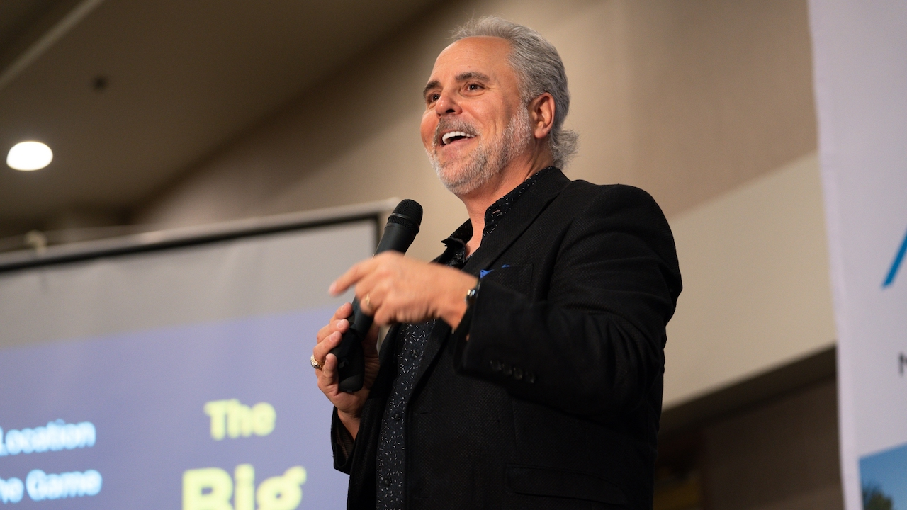 Gene Guarino speaking at a conference