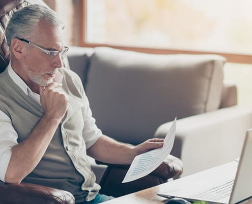 senior man monitoring investments and business